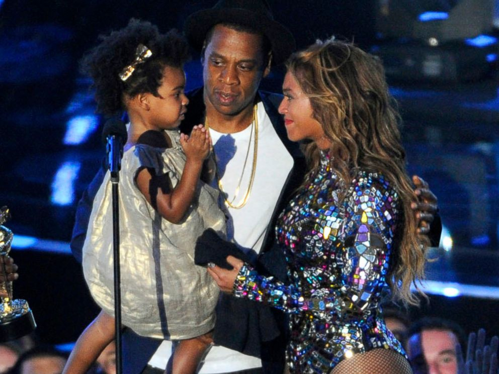 PHOTO: Beyonce on stage with Jay Z and their daughter Blue Ivy as she accepts the Video Vanguard Award at the MTV Video Music Awards in Inglewood, Calif., Aug. 24, 2014.