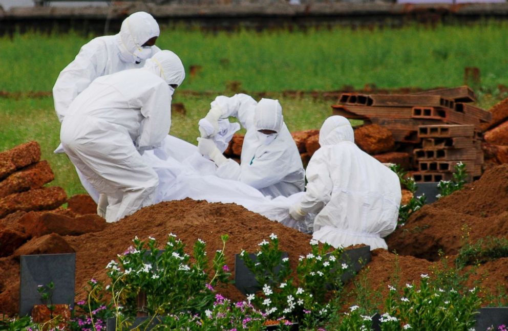PHOTO: Paramedics wear protective suits as a precautionary measure against the Nipah virus as they bury a person who died of the virus, in Kozhikode, in Kerala, India, May 24, 2018.
