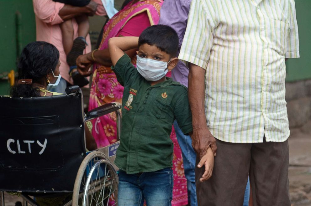 PHOTO: An Indian boy wears a mask as a precautionary measure against the Nipah virus at a hospital in Kozhikode, in the southern Indian state of Kerala, May 21, 2018.