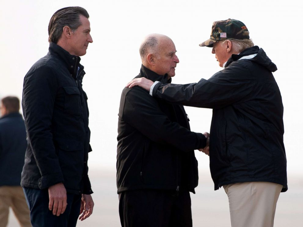PHOTO: President Donald Trump greets California Governor Jerry Brown and Governor-elect Gavin Newsom, left, as he arrives at Beale Air Force Base in California, Nov. 17, 2018.