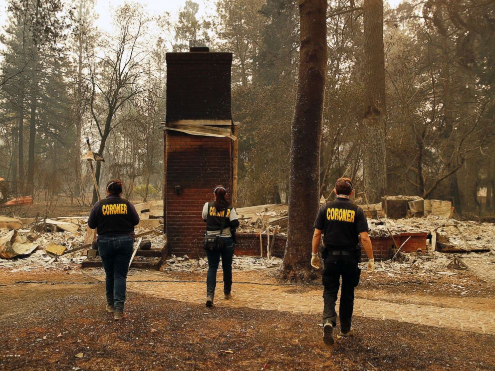 PHOTO: Members of the Sacramento County Coroners office look for human remains in the rubble of a house burned at the Camp Fire, Nov. 12, 2018, in Paradise, Calif.