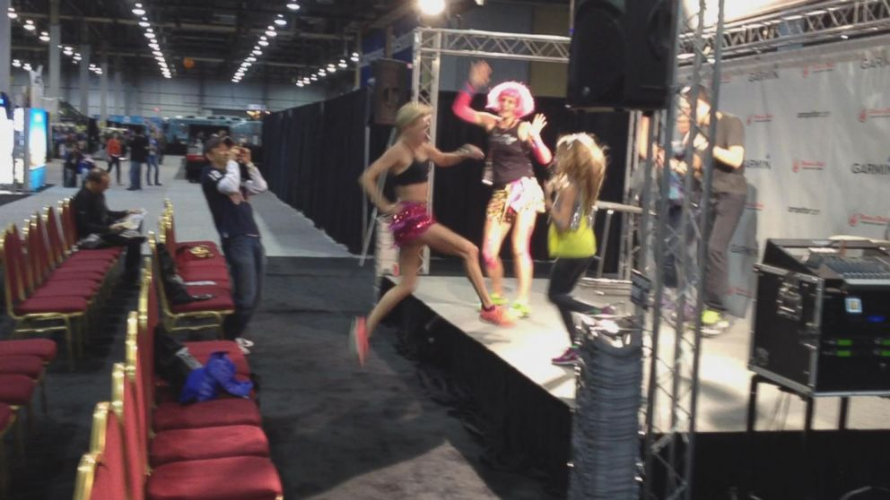 Suzy Favor Hamilton Jumps on Stage, Dances Moments Before Escort Identity  Reveal