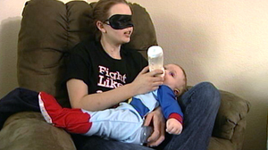 PHOTO Chrissy Steltz feeds her son a bottle. Years after a shotgun accident, Steltz fell in love.