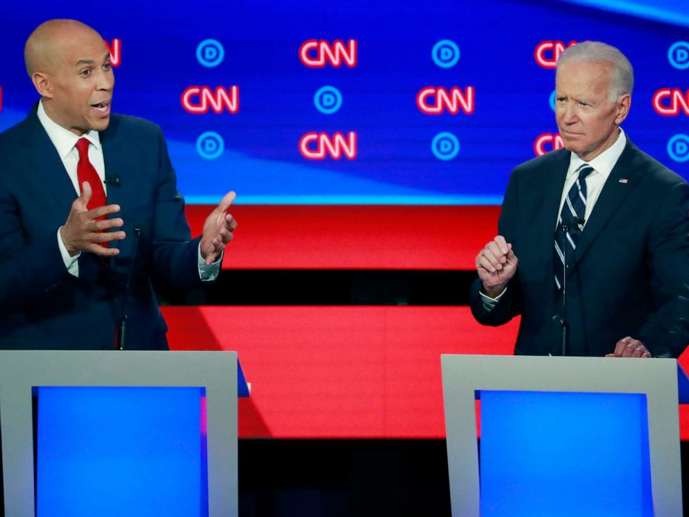 PHOTO: Sen. Cory Booker speaks as former Vice President Joe Biden gestures on the second night of the second 2020 Democratic presidential debate in Detroit, July 31, 2019.
