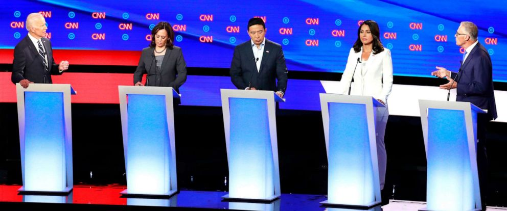 PHOTO:Governor Jay Inslee confronts former Vice President Joe Biden past Sen. Kamala Harris, entrepreneur Andrew Yang (C) and Rep. Tulsi Gabbard on the second night of the second 2020 Democratic presidential debate in Detroit, July 31, 2019.