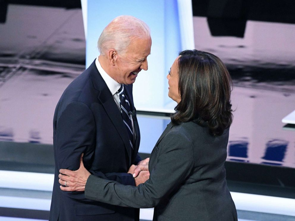 PHOTO: Democratic presidential hopefuls former Vice President Joe Biden and Sen. Kamala Harris greet each other ahead of the second round of the second Democratic primary debate in Detroit, July 31, 2019.