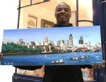PHOTO:Artist Stephen Wiltshire, who can draw detailed panoramas after seeing a city just once, stands in front of his gallery.