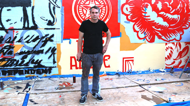 Graphic artist Shepard Fairey stands infront of his new mural going up in Wynwood Walls in Miami before the start of Art Basel Miami Beach.