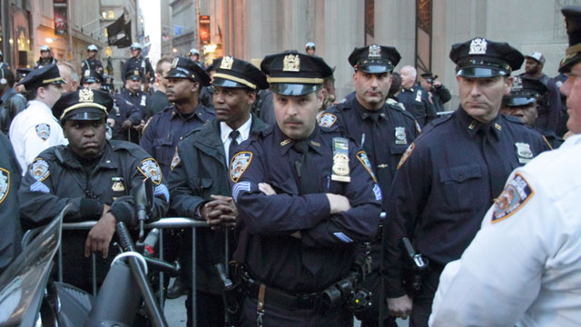 New York Police Department officers positioned along Broadway near Wall Street during a May Day 2012 demonstration.