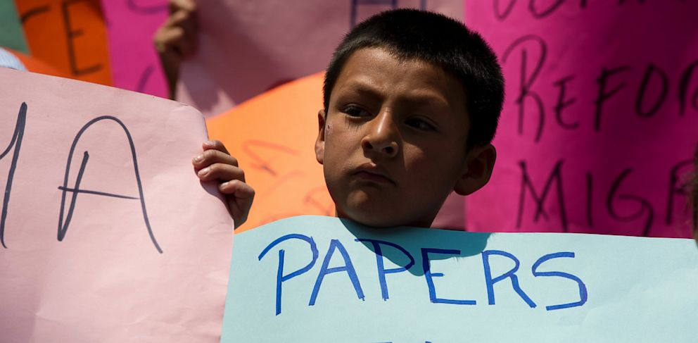 PHOTO: A boy born in the United States and deported to Mexico takes part in a protest organized by the Meso-American Migrant Movement to demand the deportation of Mexicans from the US to stop, on May 2, 2013 in front of the U.S. embassy in Mexico City.