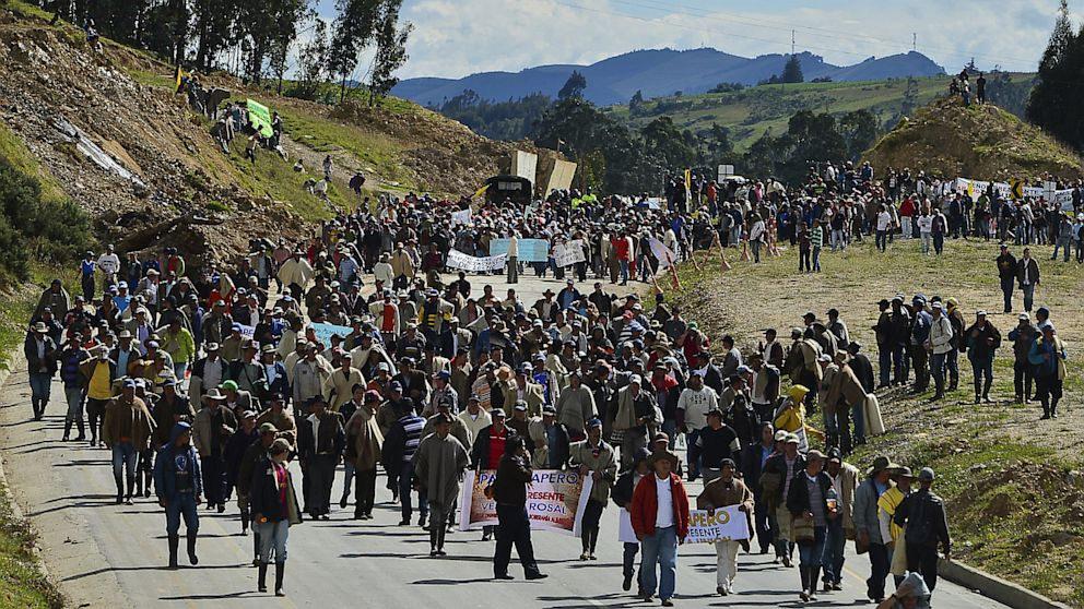 Colombian farmworkers demanding government subsidies and greater access to land march along the highway in Choconta, some 75km from Bogota, on August 22, 2013. Agrarian protests have been going on in Colombia for a week, with farmers staging roadblocks in at least 40 locations.  The protests have led to 98 arrests, and 5 deaths so far, with police reporting that 82 officers have been injured.