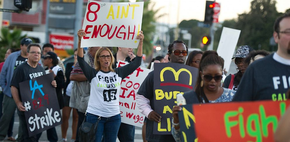 PHOTO: Fast food workers and their supporters picket outside a Burger King restaurant in Los Angeles on August 29, 2013.