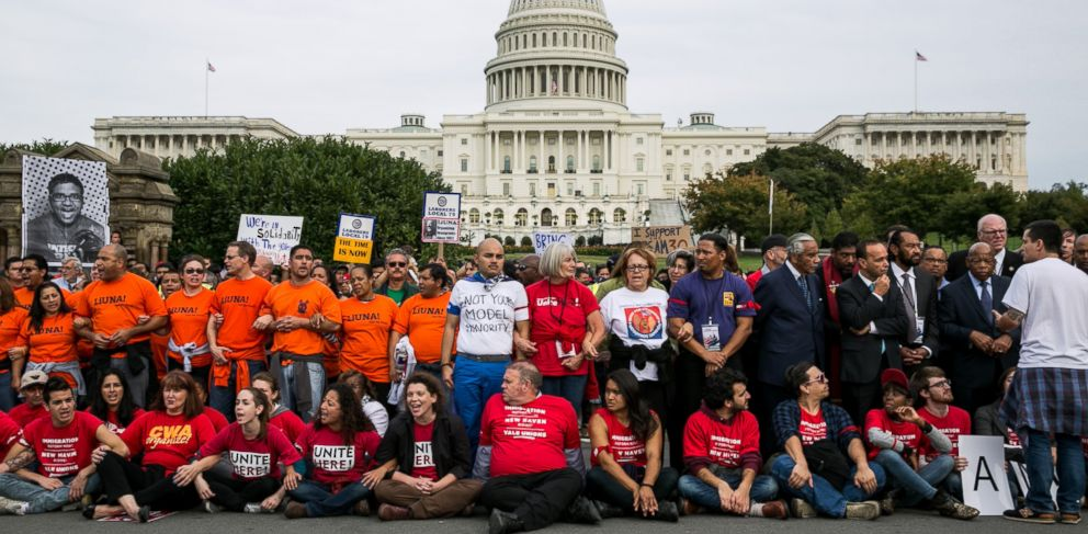 PHOTO: Supporters of immigration reform, along with several members of Congress, block First Street NW in front of the U.S. Capitol on October 8, 2013 in Washington, D.C.