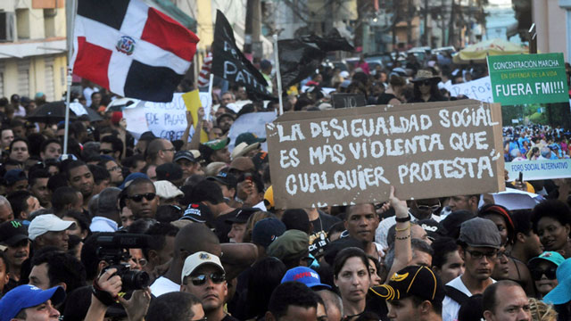 PHOTO: Dominicans attend a demonstration against the fiscal reform in Santo Domingo, Dominican Republic, Sunday, Nov. 11, 2012. The measure will increase the general sales tax to 18 percent from 16 percent, will raise the price of gasoline and impose taxe