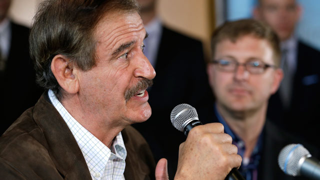 PHOTO: Former Mexican president Vicente Fox, left, speaks as Jamen Shively, CEO of Diego Pellicer, looks on during a news conference Thursday, May 30, 2013, in Seattle.