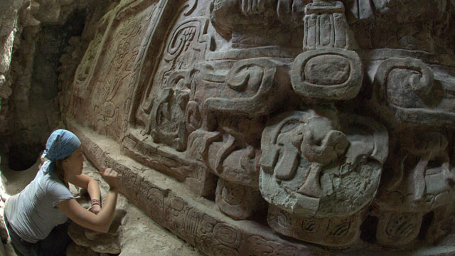 PHOTO:An archeologist cleans an inscription below a high-relief stucco sculpture recently discovered in the Mayan city of Holmul in the northern province of Peten, Guatemala. The frieze datas back to the 6th Century AD.