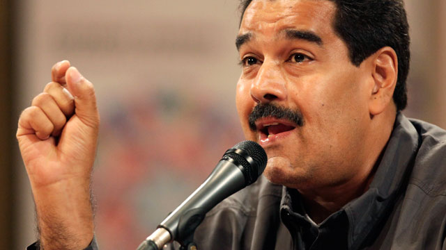 PHOTO:Venezuelas acting President Nicolas Maduro speaks at the opening of the Ninth International Book Fair of Venezuela (Filven) which pays tribute to late President Hugo Chavez at the Teresa Carreno theater in Caracas, Venezuela.