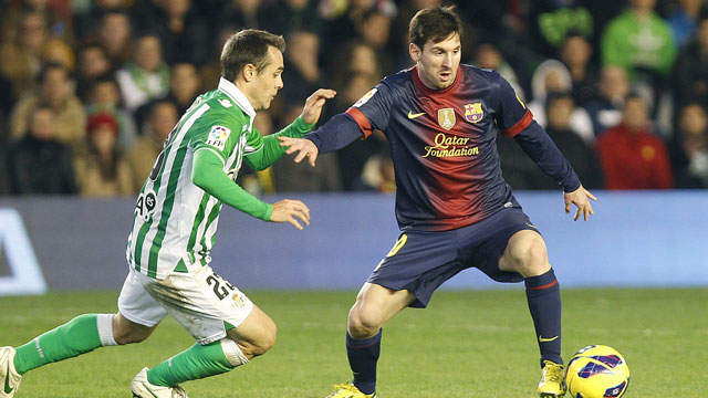 PHOTO: Barcelonas Lionel Messi from Argentina, right, and Betis Nacho Perez, left, vie for the ball during their La Liga soccer match at the Benito Villamarin stadium, in Seville, Spain on Sunday, Dec. 9, 2012