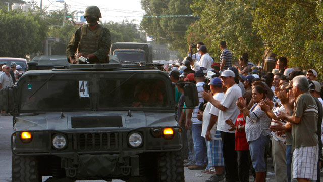 PHOTO:Mexican army soldiers entered the town of La Ruana, Michoacan on Monday, May 20, 2013. Residents of western Mexico towns who endured months besieged by a drug cartel are cheering the arrival of hundreds of Mexican army troops.