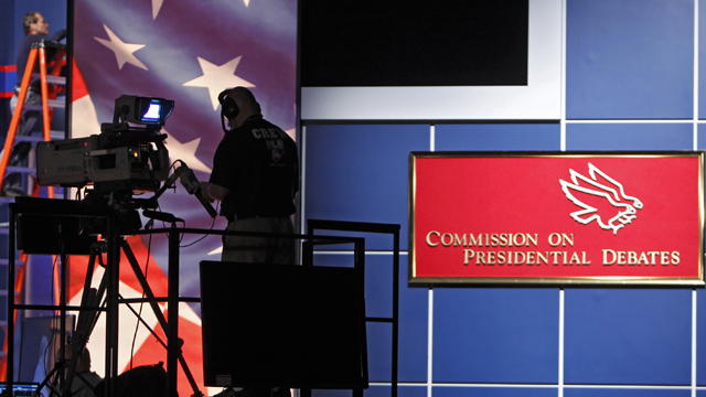 PHOTO: A tv camera man works during a rehearsal at the Magness Arena at the University of Denver, Tuesday, Oct. 2, 2012, where the first presidential debate between Obama and Republican presidential candidate Romney is scheduled for Oct. 3.