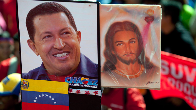 PHOTO: A picture of Venezuelas President Hugo Chavez is held up alongside an image of Jesus Christ at a rally by Chavez supporters in Caracas, Venezuela, Thursday, Jan. 10.