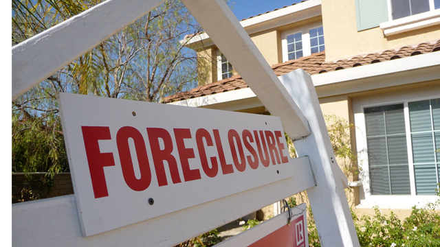 PHOTO:I didnt need to see the sign to know this house was in foreclosure. The front yard was brown, flowers dying. In a neighborhood with prices starting at $700,000 homes, its very sad.