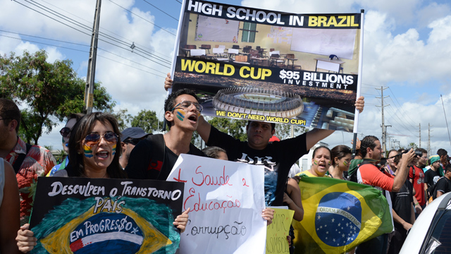 "PHOTO: In a protest staged in the city of Fortaleza, On June 19, 2013, a man held a poster which said, ""we don´t need a World Cup."""