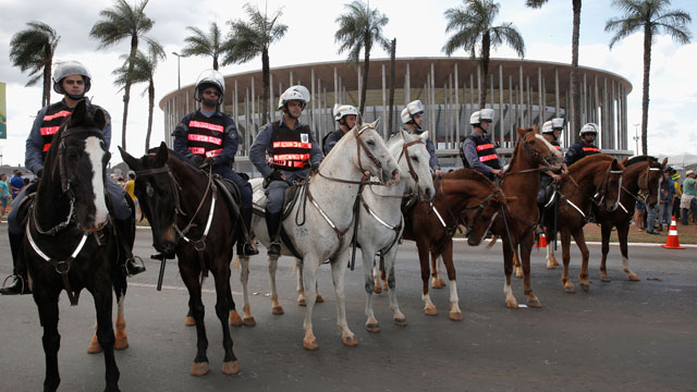 PHOTO:Security officers guard the National Stadium in Brasilia, on June 15, 2013. Large spending on world cup stadiums like this one, has sparked numerous protests in Brazil. (Dean Mouhtaropoulos/Getty Images)
