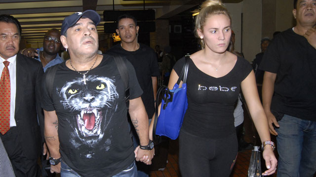 PHOTO: Diego Maradona, was planning to visit Disneyland with 23-year-old girlfriend Rocio Oliva (right), according to The Sun.