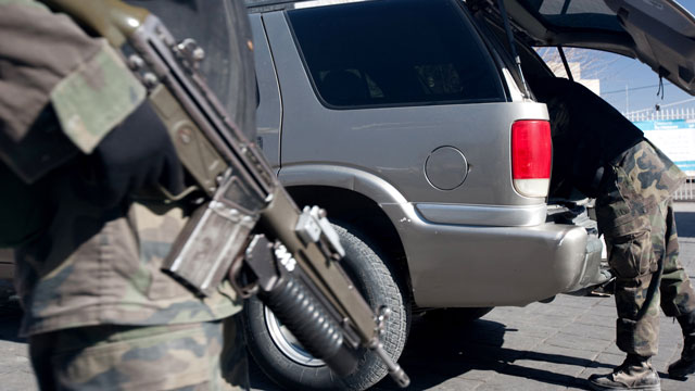 PHOTO: Soldiers search a vehicle at the Juarez Avenue border crossing into the USA on January 14, 2009 in Ciudad Juarez, Mexico. Critics of immigration reform say that new laws will make it easier for Mexican cartels to operate in the U.S.