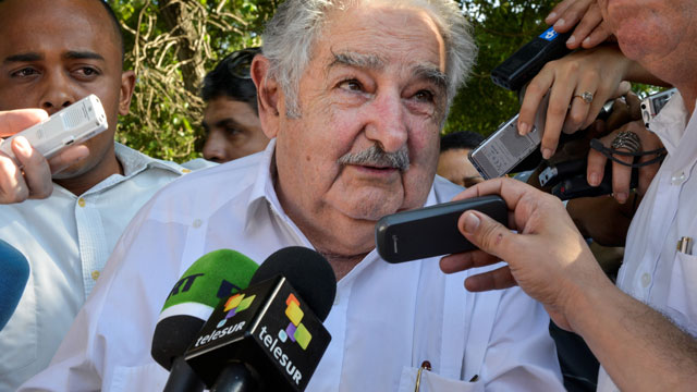 PHOTO: Uruguayan President Jose Mujica speaks with reporters during a visit to Cuba. He recently defended his drug policies on CNN saying that marijuana legalization is necessary, but that love is all you really need.