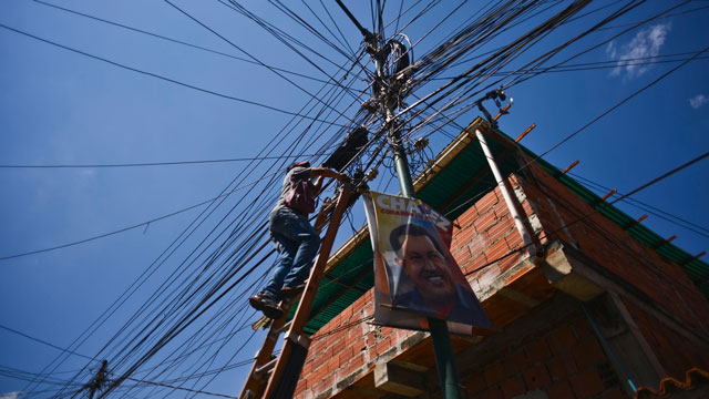 PHOTO:A technician services electrical wires in the 23 de Enero neighborhood, a stronghold of support for President Hugo Chavez, in Caracas, Venezuela, on Wednesday, Jan. 16, 2013.