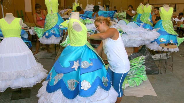 PHOTO:Women put the finishing touches on costumes for the upcoming Carnival
