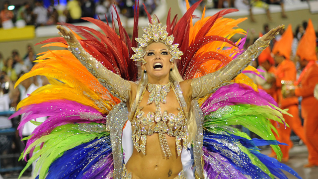 PHOTO: A reveller of Mocidade samba school dances during the first night of carnival parade at the Sambadrome in Rio de Janeiro on February 20, 2012.