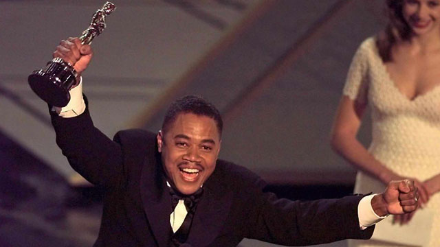 PHOTO:  Actor Cuba Gooding, Jr holds up his Oscar after winning the Best Supporting Actor Award for his role in 'Jerry Maguire' during the 69th Academy Awards