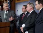 US Senator Chuck Schumer (2nd L), a Democrat from New York, speaks alongside (L-R) John McCain (R-AZ), Robert Menendez (D-NJ),Dick Durbin (D-IL) and Marco Rubio (R-FL)