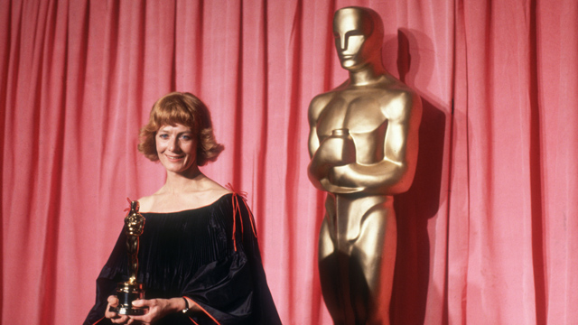 PHOTO: April 1978: British actor Vanessa Redgrave stands in front of a red curtain and a large Oscar statue, smiling and holding the Oscar she won for Best Supporting Actress in director Fred Zinnemann's film, 'Julia,' Los Angeles, California.