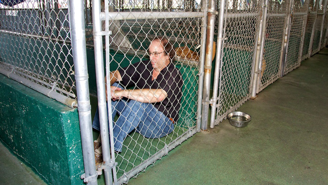 PHOTO: Michael Rosenberg inside the cage where he will live two days in order to raise awareness on animal rights.