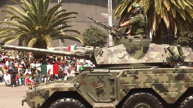 PHOTO:An armed vehicle parades the streets of Mexico City during recent independence day celebrations. Over the past six years the Mexican government has increasingly deployed the military to fight drug gangs around the country.