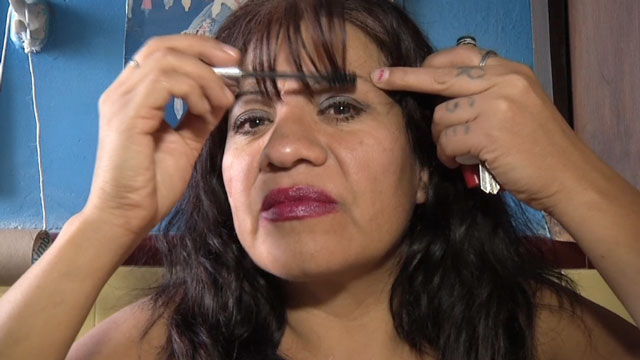 PHOTO: A sex worker that goes by the name, Merida, gets ready for her daily rounds in Mexico City. Merida is also one of ten sex workers, who are taking a journalism workshop in this city.