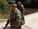 PHOTO:Soldiers patrol in San Valentin in Guatemala´s remote El Peten region,  near the border with Mexico.