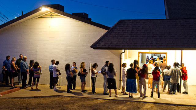 PHOTO:People wait in line to vote at the First New Life Missionary Baptist Church at 19th Ave. and Roeser, Tuesday, Nov. 6, 2012 in Phoenix.
