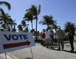 People stand in line to vote in the presidential election, Monday, Oct. 29, 2012, in Miami. About 1.9 million Floridians have already cast ballots eight days before Election Day, Nov 6.