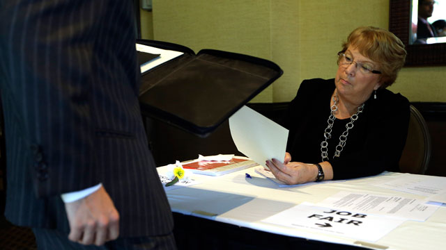 PHOTO:, Patti Maurer of Pompano Beach, Fla., right, registers a job seeker at a job fair held by National Career Fairs, in Fort Lauderdale, Fla.