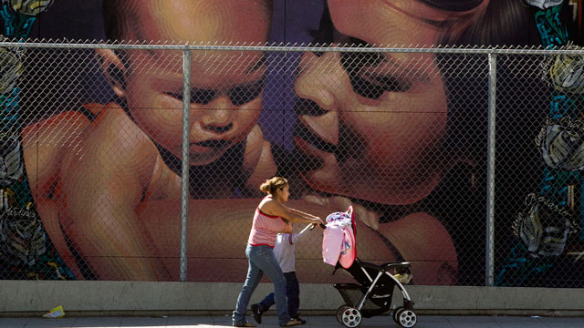 PHOTO:A mother walks with her children to the MacArthur Park Primary Center School in Los Angeles Thursday, Jan. 31, 2013. Within six months, Californias Hispanic population will equal that of whites.