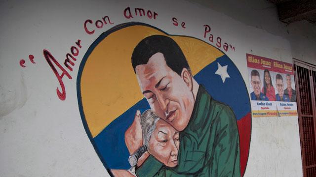 PHOTO:A heart-shaped mural shows an image of Venezuelas President Hugo Chavez hugging a woman in Caracas.