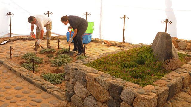 PHOTO: Forensic specialists dig at the grave of Nobel laureate Pablo Neruda as they prepare for the exhumation of the remains in Isla Negra, Chile.