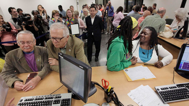 PHOTO: In this file photo taken June 1, 2011, in Chicago, Jim Darby, 79, and his partner Patrick Bora, 73, and Janean Watkins, 37, and her partner, Lakeesha Harris, 36, wait at the Cook County Office of Vital Records to obtain civil union licenses.