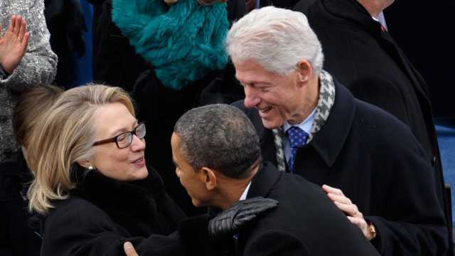 PHOTO:President Barack Obama is greeted by Secretary of State Hillary Clinton and former President Bill Clinton.