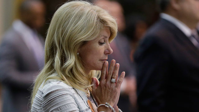 PHOTO: Sen. Wendy Davis, D-Fort Worth, reacts after she was called for a third and final violation in rules to end her filibuster attempt to kill an abortion bill, Tuesday, June 25, 2013, in Austin, Texas.